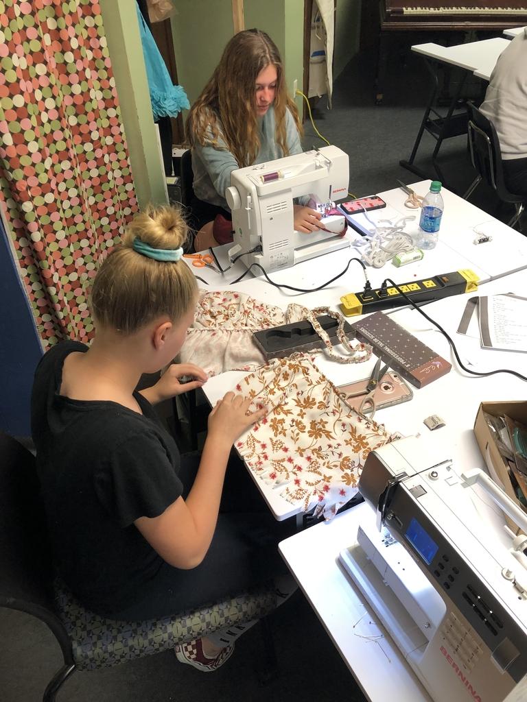 Fashion Design students working on their repurposing project.