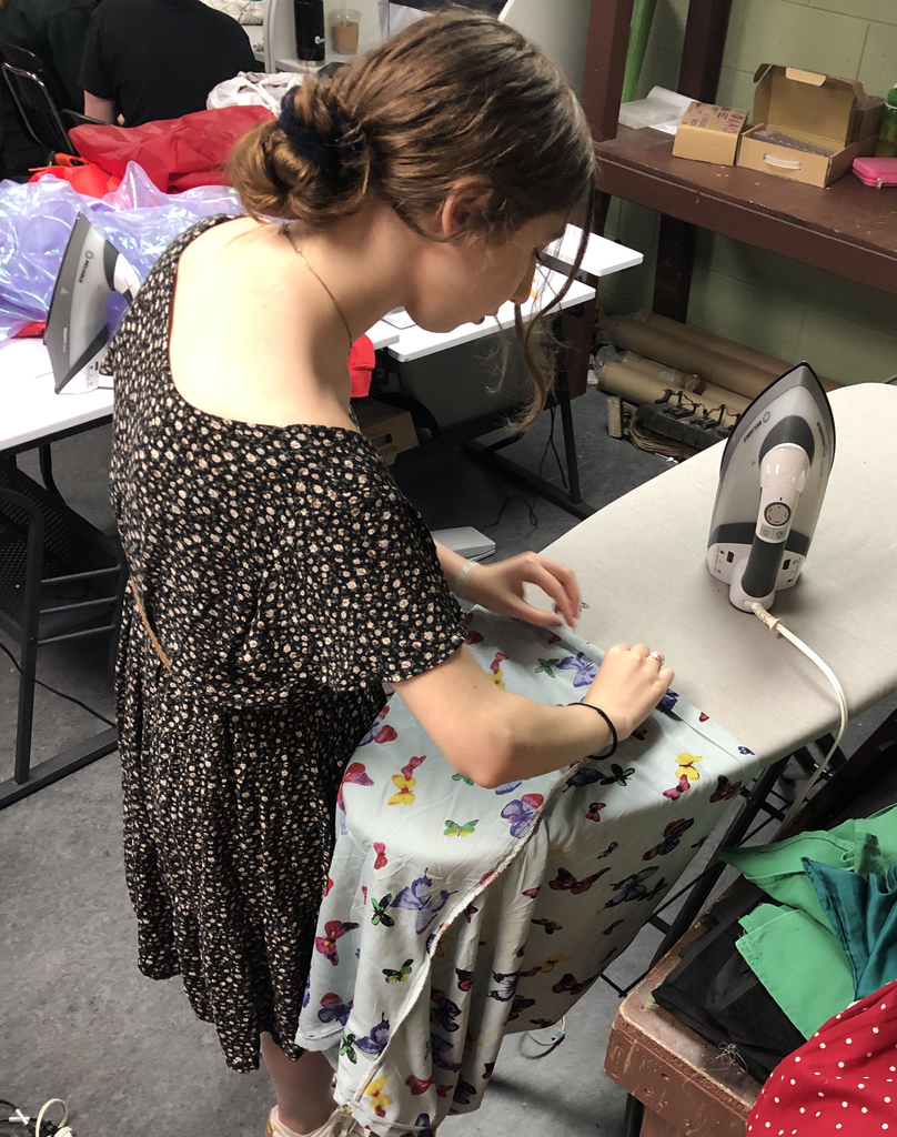 "Senior Or-yah Rudick is preparing to hem her ""new"" dress."